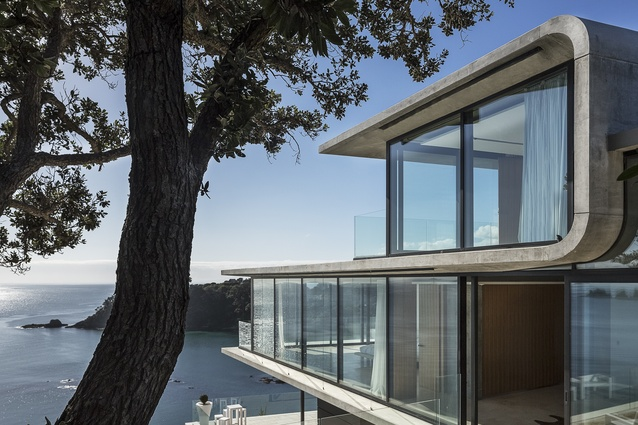 Nothing if not confident: the concrete house cantilevers out towards a Waiheke bay.