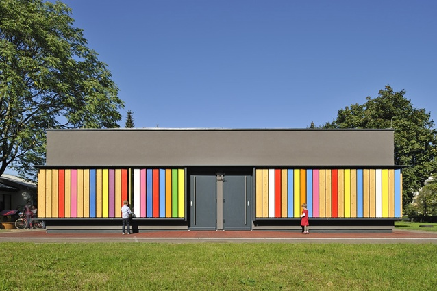 Kindergarten Kekec by Arhitektura Jure Kotnik, Slovenia. Toy slats allow for a play and educational element, where children can turn the wooden planks to show different colours.