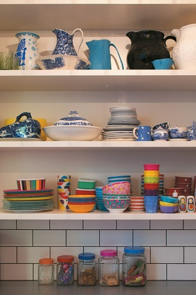 Kitchen shelves lined with blue and white china collected from junk shops across Europe.