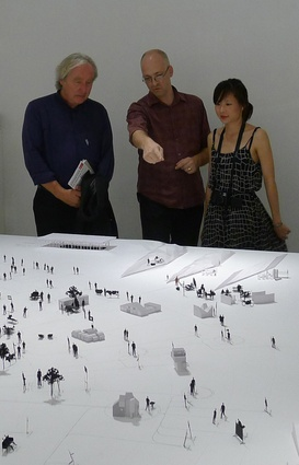 Andrew Barrie and Melanie Pau explain the installation to Steven Holl.