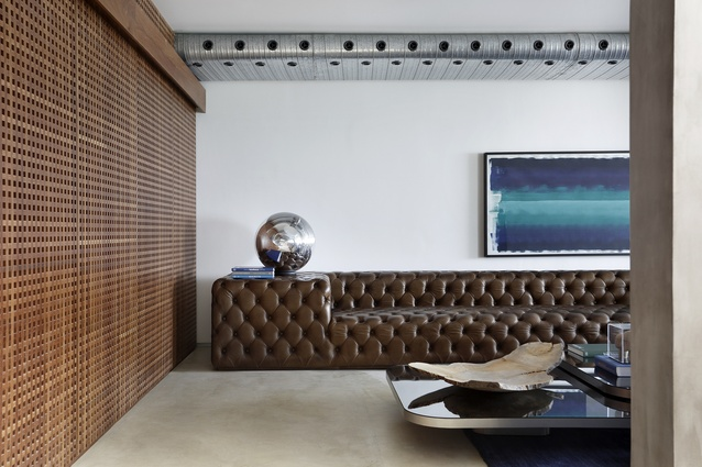 The sofa, a 21st century take on the Chesterfield sofa, grounds this living room.