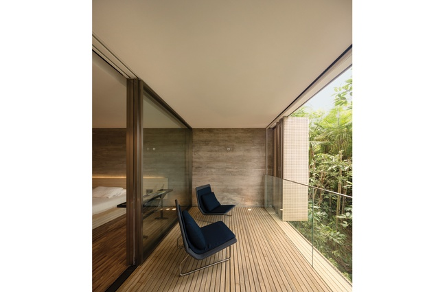 Each bedroom has a small covered deck with Sand armchairs.