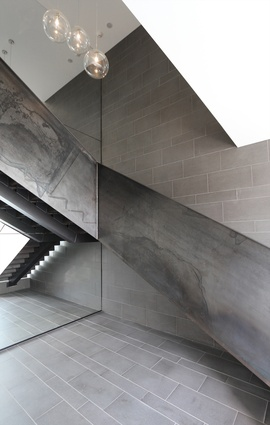 408 Anglesea Street, Hamilton. The entry foyer features a raw steel staircase.