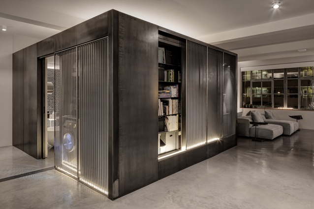 The metallic cube's sliding mesh panels, cupboards and niches allow each face to fulfil a different purpose.