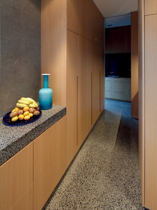 Throughout the interior, built-in cabinetry adds to a sleek, uncluttered look.