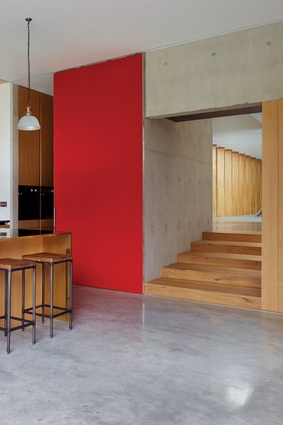 Colour accents throughout the house provide a strong contrast with the timber and concrete material palette.