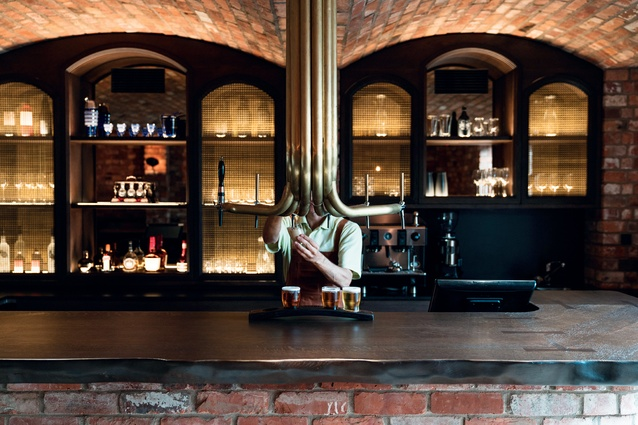 The brass beer taps are suspended from the ceiling in the Alibi bar.