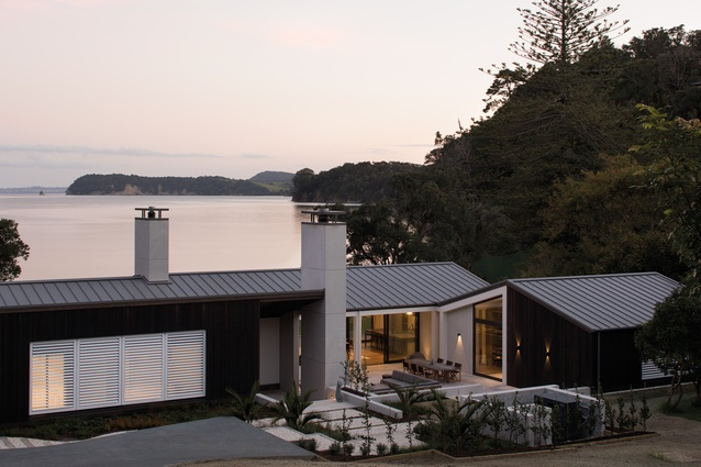 Scotts Landing: The northern elevation shows the living area with its inverted butterfly roof.