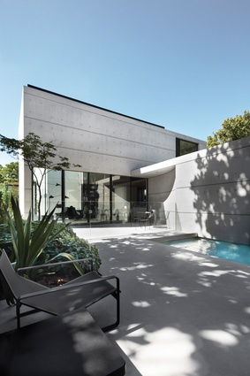 The new concrete, glass and dark steel wing has the same elegant intricacy as the original villa.