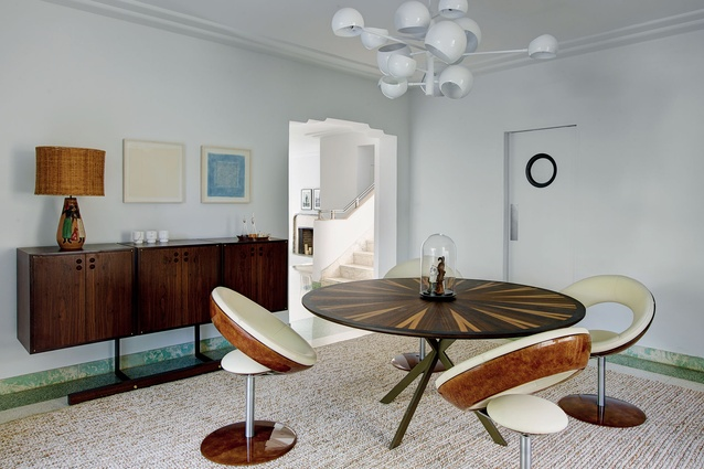 Brazilian vintage pieces (such as the circular Anel dining chairs) sit alongside contemporary European pieces.