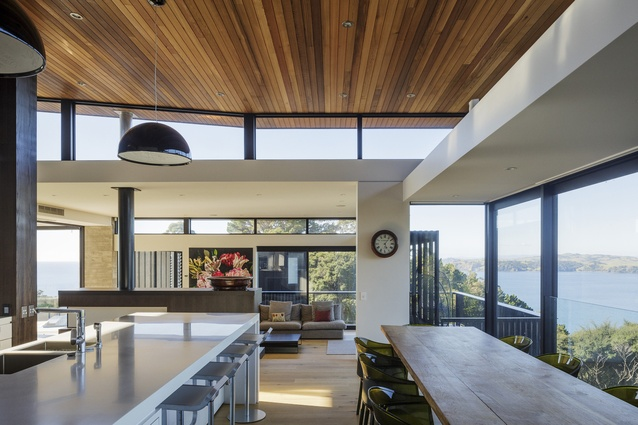 An open-plan living and dining area in the Onetangi House makes the most of the home's position overlooking the ocean.
