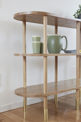 The shelf features curved ends.