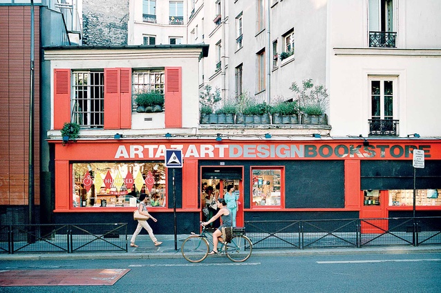 A colourful shopfront stands out on a Parisian rue.