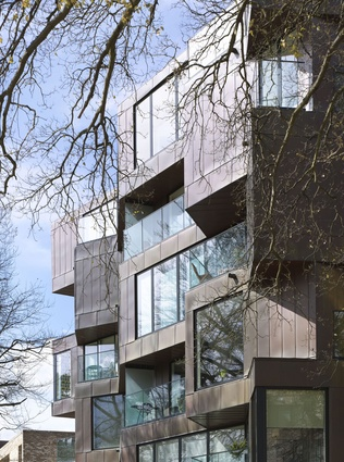 Accordia Brass Building in Cambridge, UK, is a 12-unit apartment building, part of a 400-unit masterplanning scheme that won the RIBA Stirling Prize in 2008.