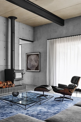 Flack's furniture selection includes the classic Eames lounge chair and ottoman.