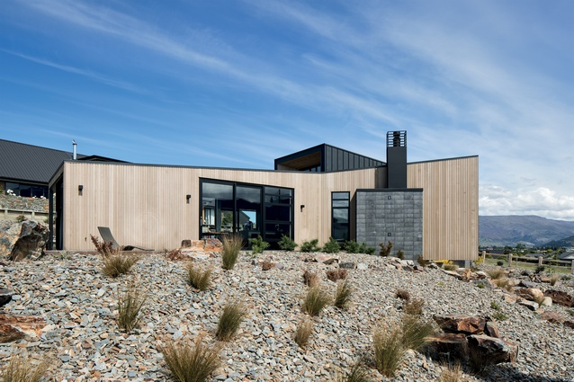 Cantilevered over a rock garden, the living wing is clad in timber and looks out towards Lake Wanaka.