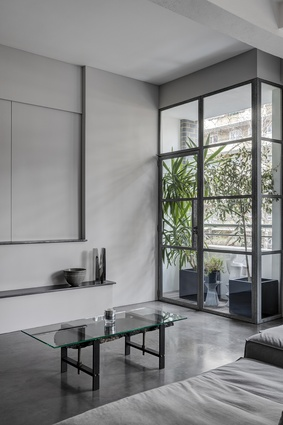 The architect has accented a predominantly monochrome palette with moments of rich olive green and steely blue.