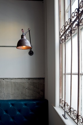 Vintage-look lighting and metal window screens add to the character.