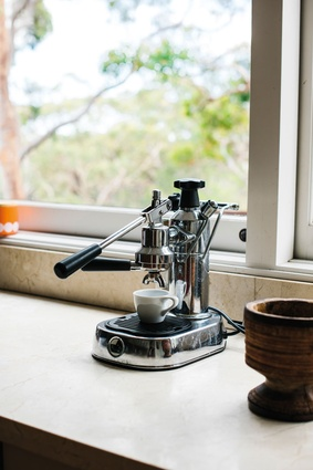 "La Pavoni coffee machine. ""We bought it in Italy before we got married so it's 23 years old and hasn't missed a beat. There are faster ways to make coffee but this manual machine slows us down."""