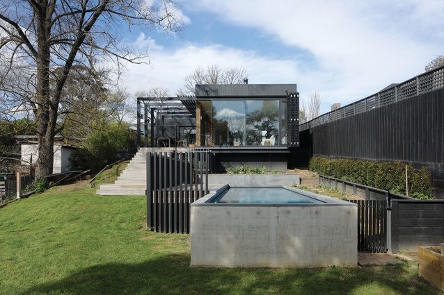 The addition is terraced down the site toward Darebin Creek, connecting all rooms to the bushy surrounds.