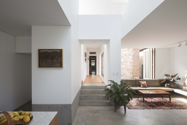 The living room opens up to a courtyard, which is lined in recycled brick that was salvaged from the old house.