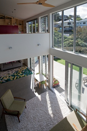 The double-height living area has a casual lounge above for the children, but is still open to allow for communication with the parents downstairs.