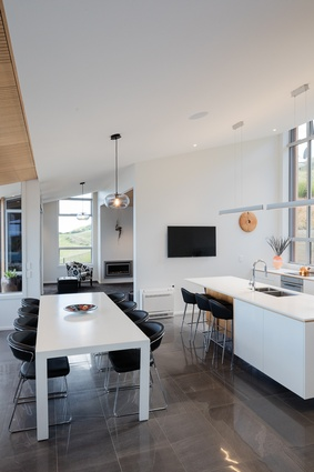 The kitchen/dining area has views to the front and back and enjoys cross ventilation.