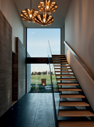 In the entry circulation space, windows capture selected views of the rural landscape.
