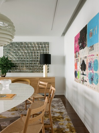 The dining room's bold artworks include a colourful piece by Angolan artist Yonamine.