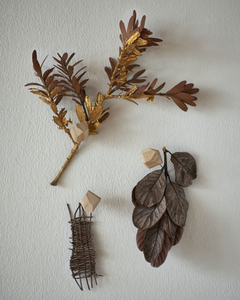 "Gold kauri branch: ""This is a branch from a tree in our garden,"" says Leanne. ""And an artwork I created out of concern for these native trees which are in danger of extinction."""