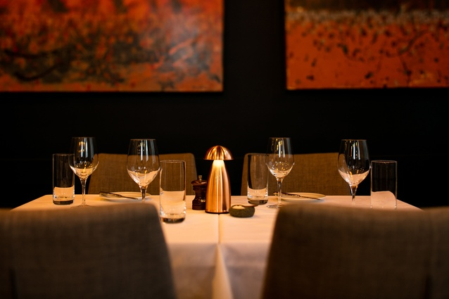 Natural tones, copper, plush seating and better acoustics improve on the restaurant's original space.