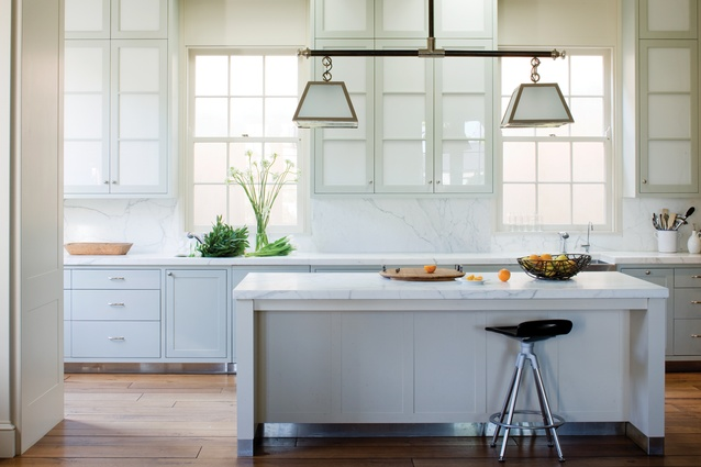 Calacatta marble benchtops are a feature in the kitchen.