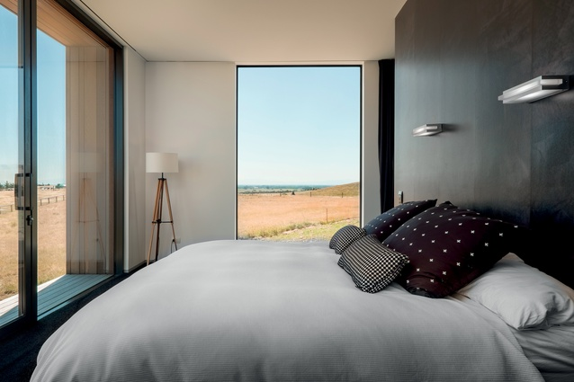 The main bedroom has black walls, carpet and curtains to contain the stunning scenery outside.