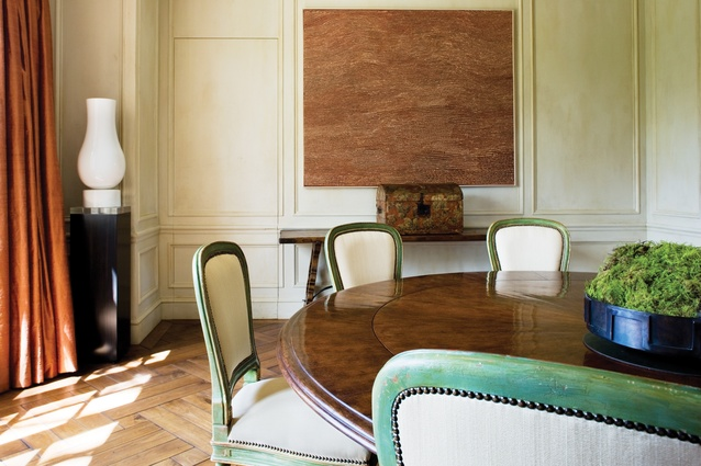 The formal panelled dining room has a circular fruitwood table.