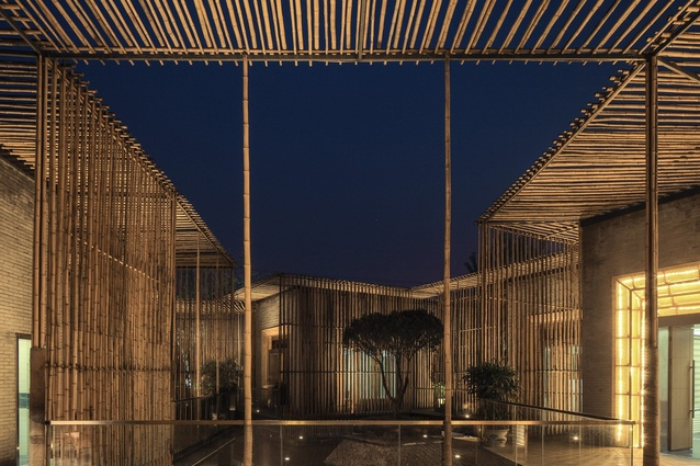 Bamboo Courtyard Teahouse, China by HWCD. This floating boutique teahouse features bamboo that is vertically and horizontally arranged for visual effect and depth.