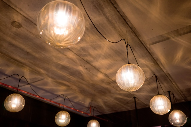 Luke Jacomb created the blown-glass lights, which are strung in a casual fashion over the downstairs space.