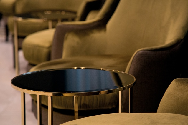 Circular shapes and furniture with a mixture of eras and influences offer a comforting yet luxurious atmosphere to the hotel lobby.