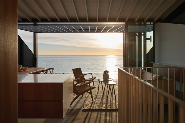 The ocean is strategically framed to eliminate all neighbouring properties from view, enabling a more intimate connection with the water despite the home's suburban context.