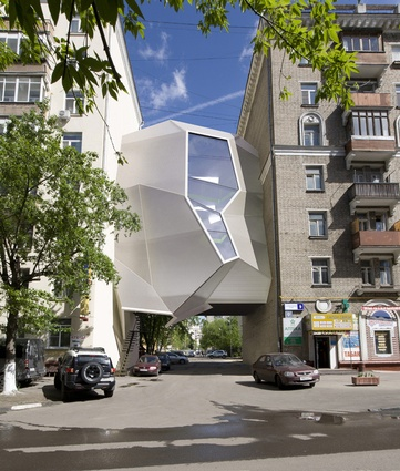 Parasite Office, Moscow by za bor architects. Built in 2011 for the architects' own studio. The polygonal main façade is made from light and durable cellular polycarbonate.
