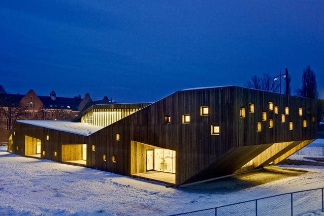 Fagerborg Kindergarten, Norway by Reiulf Ramstad Architects. One end of the organic-looking building cantilevers to create a sheltered entrance space.
