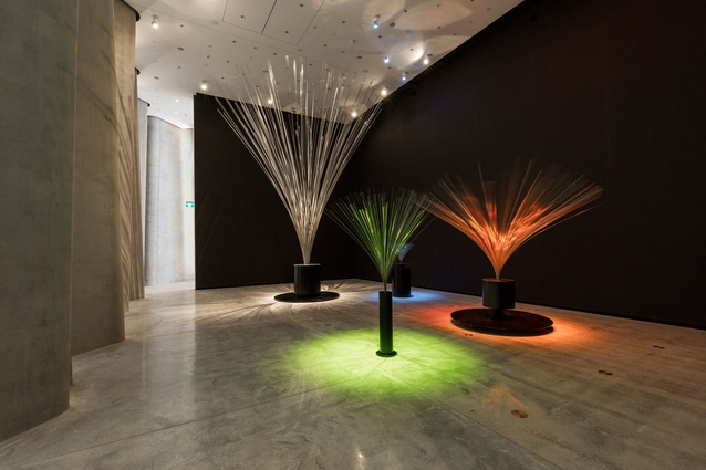 Lye's iconic fountains, silently rotating, casting twirling light and shadows upon every surface.