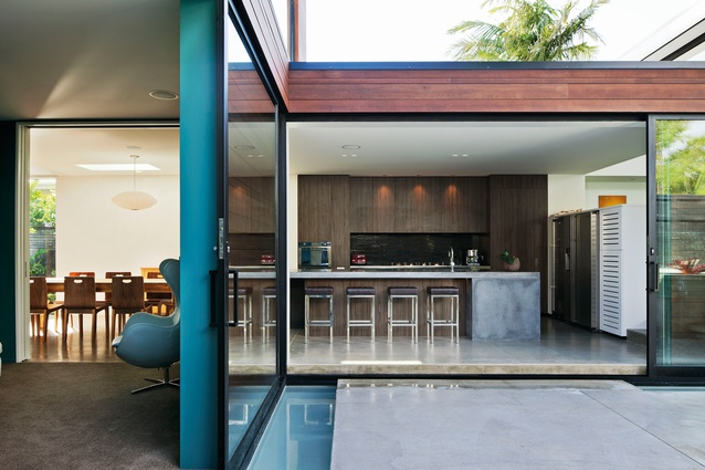 Misaligned House: A garden courtyard is the focal point to the internal living areas, which are designed as visually connected social spaces.