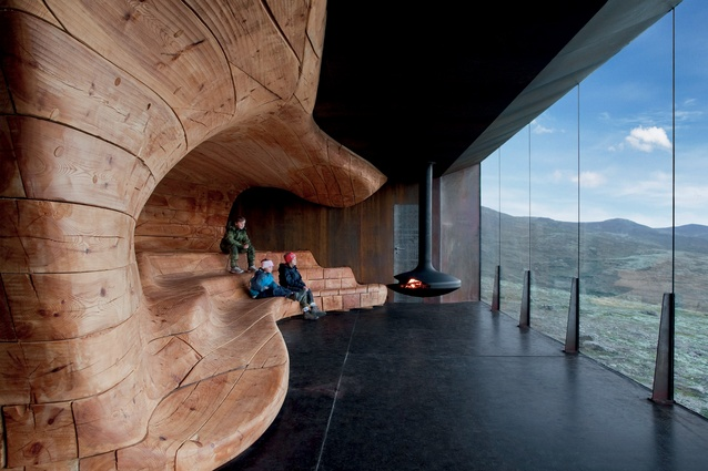 Tverrfjellhytta, the Norwegian Wild Reindeer Pavilion, designed by Snøhetta, at Hjerkinn, has a wooden core shaped like rock or ice eroded by natural forces.