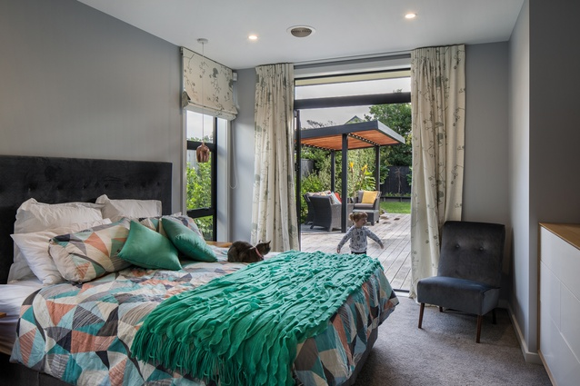 Bedrooms are in wings on either side of the living space.