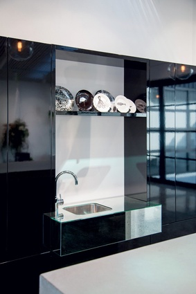 High-gloss, wall-hung cabinets with mirror vanity.