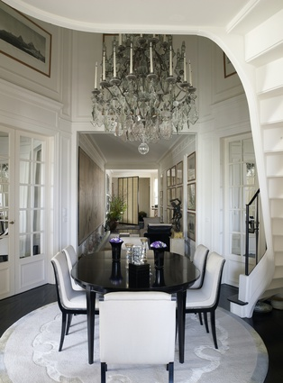 One of Takada's favourite pieces in the apartment – a Mathieu Lustrerie chandelier – adorns the monochrome dining room.