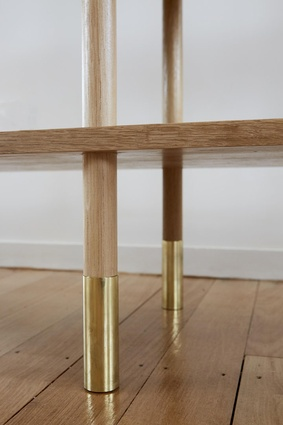A close up of the brass leg detailing on the Aspect shelf.