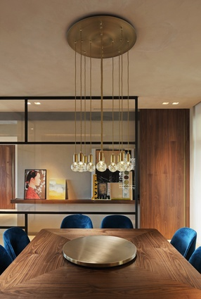 Lee Broom pendants hang above the bespoke dining table surrounded by Flexform Mood Judit dining chairs.