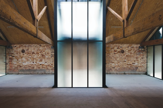 The sandblasted glass lightwells that eventually terminate in the groundfloor laneway also bring illumination to the second-floor space.