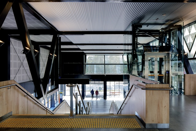Looking back at the main entrance and lobby, which sit at ground level, before rising to create an elevated concourse linking platforms as well as an existing pedestrian overbridge.